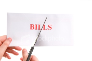 stock-photo-5775860-cutting-bills-in-half